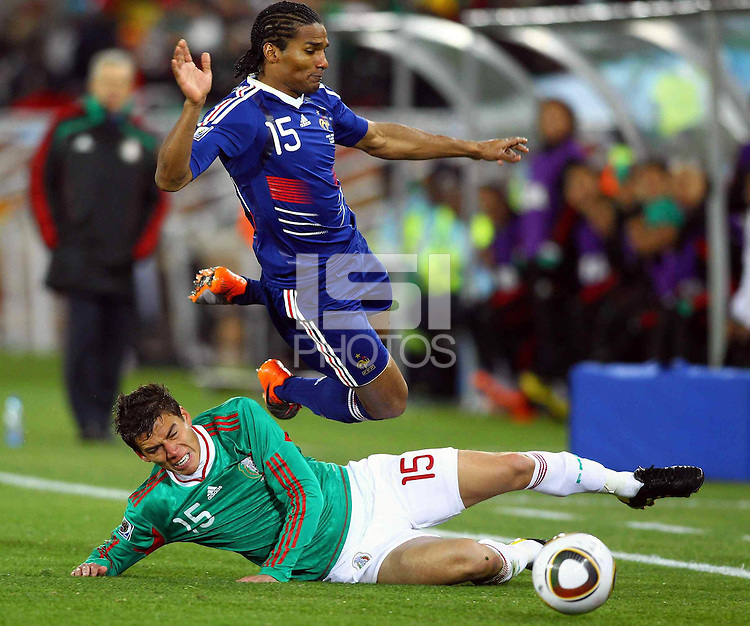 Hector Moreno of Mexico (L) and Florent Malouda of France