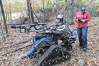 NWA Democrat-Gazette/FLIP PUTTHOFF <br /> An all-terrain chair holds Swope's crossbow on a stand Oct. 26, 2016 while his wife, Jackie, steers the chair with a control box.