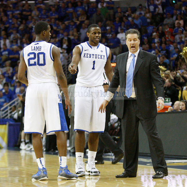 UK Head Coach John Calipari instructs guard Darius Miller during the second half in the 2012 SEC Tournament championship game between Kentucky and Vanderbilt, played at New Orleans Arena, on 3/11/12.  Photo by Quianna Lige | Staff