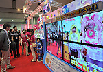 June 16th, 2011, Tokyo, Japan - Visitors watch the video display at the Bandai booth as the International Tokyo Toy Show 2011 opens in Tokyo Thursday, June 16, 2011. More than 130 domestic and foreign toy manufacturers and companies featured about 35,000 toys in the four-day show, the largest of its kind in Japan.  The domestic toy market grew 3.5 percent in the business year ended in March from a year earlier, the first increase in three years, according to the Japan Toy Association. (Photo by Natsuki Sakai/AFLO) [3615] -mis-