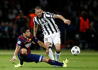 Calcio, finale di Champions League Juventus vs Barcellona all'Olympiastadion di Berlino, 6 giugno 2015.<br /> FC Barcelona's Luis Suarez, right, and Juventus' Leonardo Bonucci fight for the ball during the Champions League football final between Juventus Turin and FC Barcelona, at Berlin's Olympiastadion, 6 June 2015. Barcelona won 3-1.<br /> UPDATE IMAGES PRESS/Isabella Bonotto
