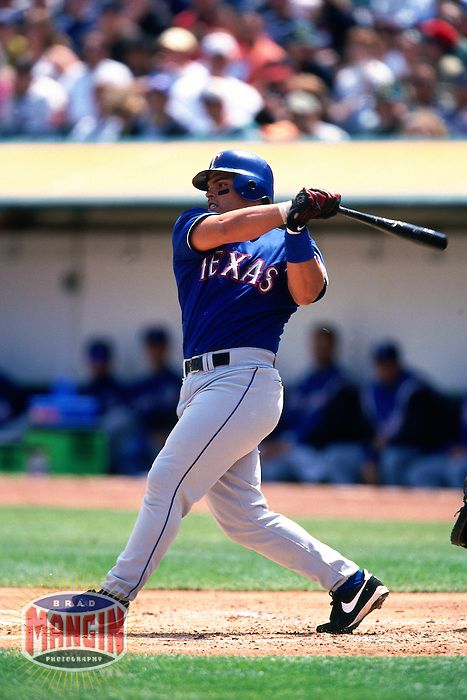 OAKLAND, CA - Ivan Pudge Rodriguez of the Texas Rangers bats during a game against the Oakland Athletics at the Oakland Coliseum in Oakland, California on April 14, 2001. Photo by Brad Mangin