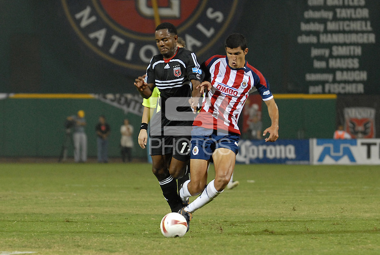 DC United forward Luciano Emilio (11) battles for possession of the ball against CD Chivas defender Francisco Javier Rodriguez (3). DC United defeated CD Guadalajara 2-1 in the first game of a home and home round of 16 match in the 2007 Copa Nissan Sudamericana at RFK Stadium in Washington DC, on Wednesday September 26, 2007.