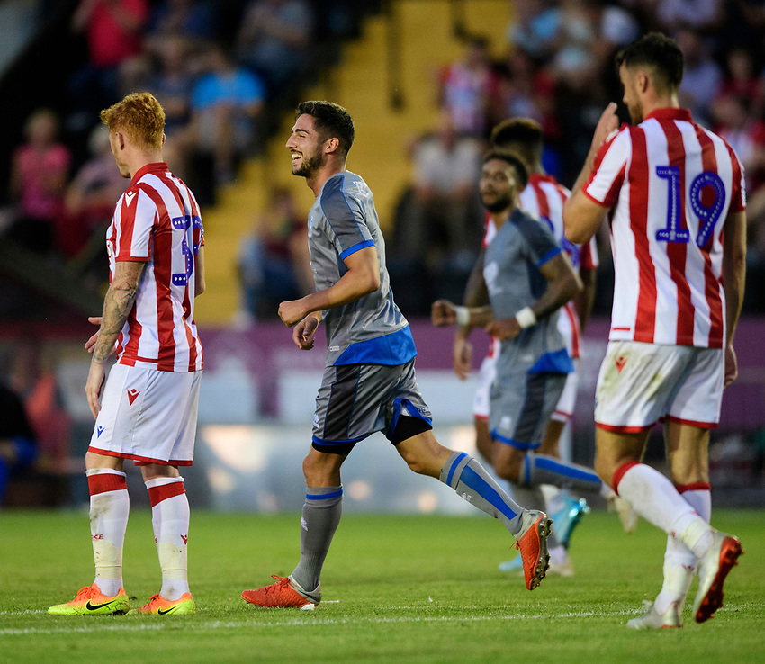 Lincoln City's Tom Pett celebrates scoring his side's first goal<br /> <br /> Photographer Chris Vaughan/CameraSport<br /> <br /> Football Pre-Season Friendly - Lincoln City v Stoke City - Wednesday July 24th 2019 - Sincil Bank - Lincoln<br /> <br /> World Copyright © 2019 CameraSport. All rights reserved. 43 Linden Ave. Countesthorpe. Leicester. England. LE8 5PG - Tel: +44 (0) 116 277 4147 - admin@camerasport.com - www.camerasport.com