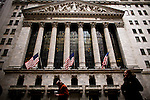 People walk in front of the New York Stock Exchange while Mc Donald's Management discusses Q4 2011 results in New York, United States. 23/01/2012.  Photo by Eduardo Munoz Alvarez / VIEWpress.