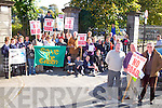 SAVE OUR GREEN: Kieran Moriarty, Tommy Collins and Eddie Riordan of the Save Our Green committee with the large group of protesters outside the West Gate of Tralee Town Park on Thursday.