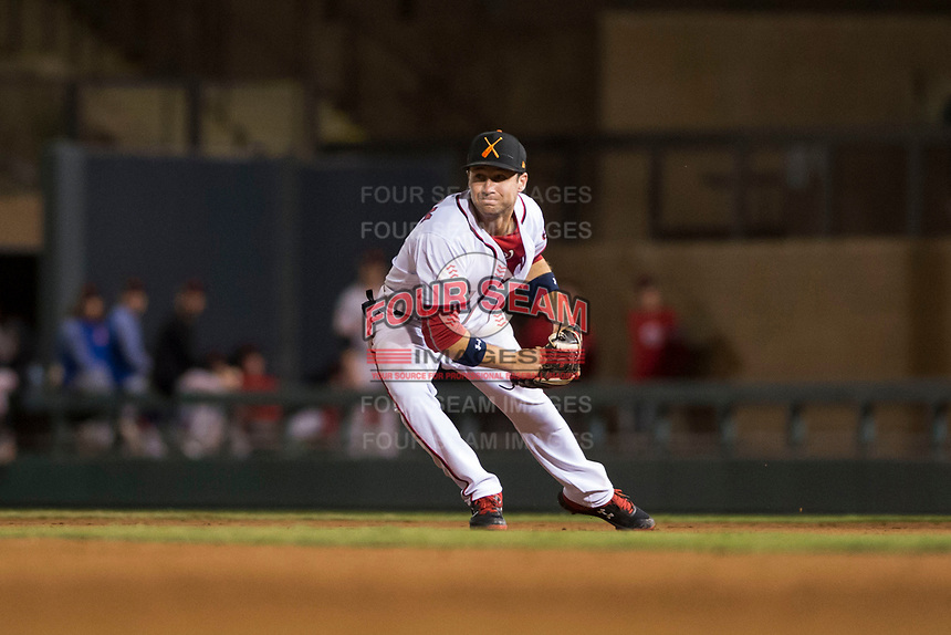 Salt River Rafters second baseman Carter Kieboom (24), of the Washington Nationals organization, prepares to flip to the shortstop during an Arizona Fall League game against the Scottsdale Scorpions at Salt River Fields at Talking Stick on October 11, 2018 in Scottsdale, Arizona. Salt River defeated Scottsdale 7-6. (Zachary Lucy/Four Seam Images)