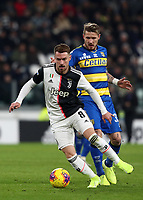 Calcio, Serie A: Juventus - Parma, Turin, Allianz Stadium, January 19, 2020.<br /> Juventus' Aaron Ramsey (in front of) in action with Parma's Juraj Kucka (behind) during the Italian Serie A football match between Juventus and Parma at the Allianz stadium in Turin, January 19, 2020.<br /> UPDATE IMAGES PRESS/Isabella Bonotto