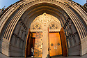 Early on January 1, Ann Hall of chapel services opens the portal doors on Duke chapel for the first time in 2015. For a number of days around the winter solstice, the portal of Duke Chapel receives direct illumination at sunrise.