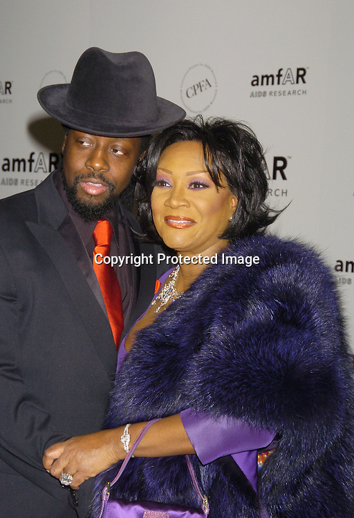 Wyclef Jean and Patti LaBelle ..at The Annual amFar Benefit on November 30, 2004 at ..The Pierre Hotel in New York City. Patti LaBelle, Sumner Redstone and Peter Dolan were honored. ..Photo by Robin Platzer, Twin Images