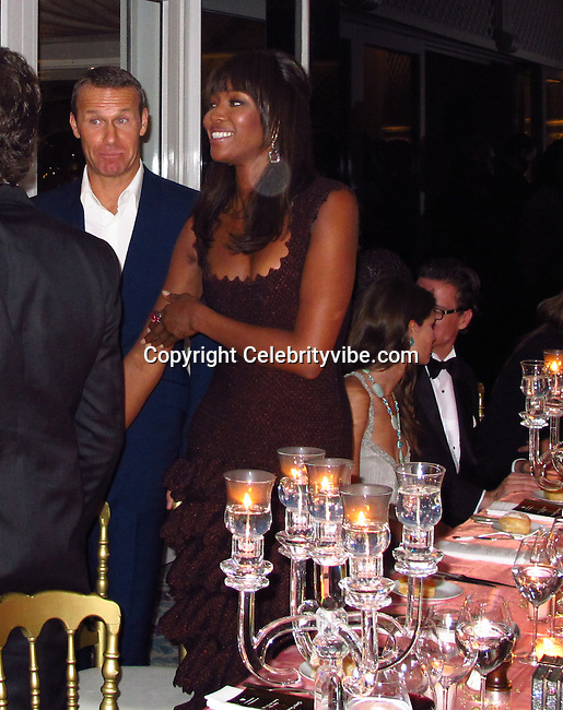 Vladimir Doronin and Naomi Campbell..2011 Cannes Film Festival..Eden Roc Restaurant at Hotel Du Cap..Cap D'Antibes, France..Tuesday, May 17, 2011..Photo By CelebrityVibe.com..To license this image please call (212) 410 5354; or.Email: CelebrityVibe@gmail.com ;.website: www.CelebrityVibe.com