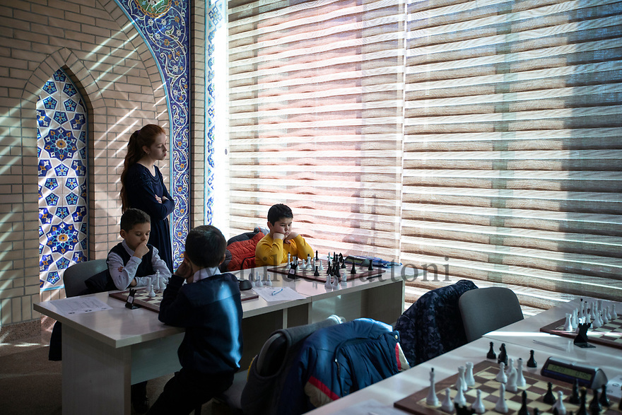 Uzbekistan - Tashkent - Students participating in a chess tournament at the Republic's Specialized Chess Academy for Youth. The school was built in 2016 and the idea was from Islam Karimov. Kids are between the age of 7 to 17, they only play chess, nothing else. The school has 334 students and 14 trainers who are professional players.