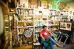 Barry Sakata reads in his office at the b. sakata garo gallery in Sacramento, California.