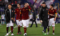Calcio, Europa League: Ritorno degli ottavi di finale Roma vs Fiorentina. Roma, stadio Olimpico, 19 marzo 2015.<br /> From left, Roma's Leandro Paredes, Davide Astori, Daniele De Rossi, Morgan De Sanctis and Alessandro Florenzi react at the end of the Europa League round of 16 second leg football match between Roma and Fiorentina at Rome's Olympic stadium, 19 March 2015. Fiorentina won 3-0.<br /> UPDATE IMAGES PRESS/Isabella Bonotto