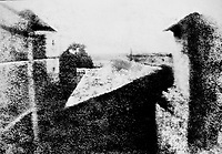 View from the Window at Le Gras, the first successful permanent photograph created by Nicéphore Niépce in 1826, Saint-Loup-de-Varennes. Captured on 20 × 25 cm oil-treated bitumen. Due to the 8-hour exposure, the buildings are illuminated by the sun from both right and left.<br /> <br /> Vue de la fenêtre du domaine du Gras, à Saint-Loup-de-Varennes. Première photographie permanente jamais réalisée, sur bitume de Judée. Le soleil a éclairé le mur de droite puis celui de gauche plus tard dans la journée, la pose ayant duré des heures.