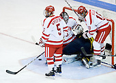 David Warsofsky (BU - 5), Grant Rollheiser (BU - 35), Joe Cucci (Merrimack - 14), Wade Megan (BU - 18) - The Boston University Terriers defeated the Merrimack College Warriors 6-4 (EN) on Saturday, January 16, 2010, at Agganis Arena in Boston, Massachusetts.
