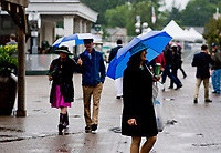 LOUISVILLE, KENTUCKY - MAY 04: People walk in the downpour with their umbrellas during Thurby at Churchill Downs on May 4, 2017 in Louisville, Kentucky. (Photo by Scott Serio/Eclipse Sportswire/Getty Images)