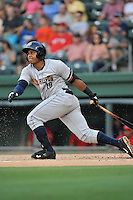 First baseman Isaias Tejeda (19) of the Charleston RiverDogs bats in a game against the Greenville Drive on Friday, August 14, 2015, at Fluor Field at the West End in Greenville, South Carolina. Charleston won 6-2. (Tom Priddy/Four Seam Images)