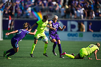 Orlando, Florida - Sunday, May 8, 2016: Seattle Reign FC midfielder Keelin Winters (11) protects the ball from Orlando Pride midfielder Kaylyn Kyle (6) and Orlando Pride forward Josee Belanger (9) during a National Women's Soccer League match between Orlando Pride and Seattle Reign FC at Camping World Stadium.