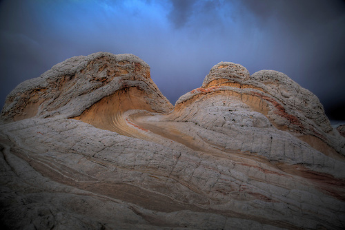 Stormy weather provides the background of the unusual rock formations at White Pocket at Vermillion Cliffs National Monument in Northern Arizona.