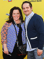 SANTA MONICA, CA, USA - NOVEMBER 16: Melissa McCarthy, Ben Falcone arrives at the P.S. ARTS Express Yourself 2014 held at The Barker Hanger on November 16, 2014 in Santa Monica, California, United States. (Photo by Celebrity Monitor)