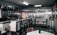 Empty coffee shop with stainless steel walls.