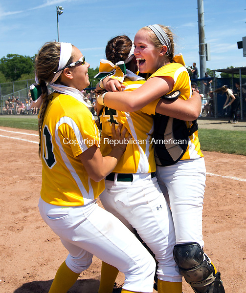 West Haven, CT- 13 June 2015-061315CM15-   Holy Cross' Sarah Lawton, center, catcher Paige Hine, right and Elizabeth Lombardo #20 celebrate following a 4-0 win over Thomaston to capture the Class S state softball title in West Haven on Saturday.  Christopher Massa Republican-American