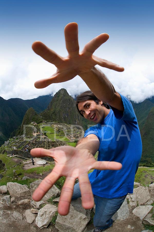 A tourist visits the ancient Inca ruins of Machu Picchu, Peru.