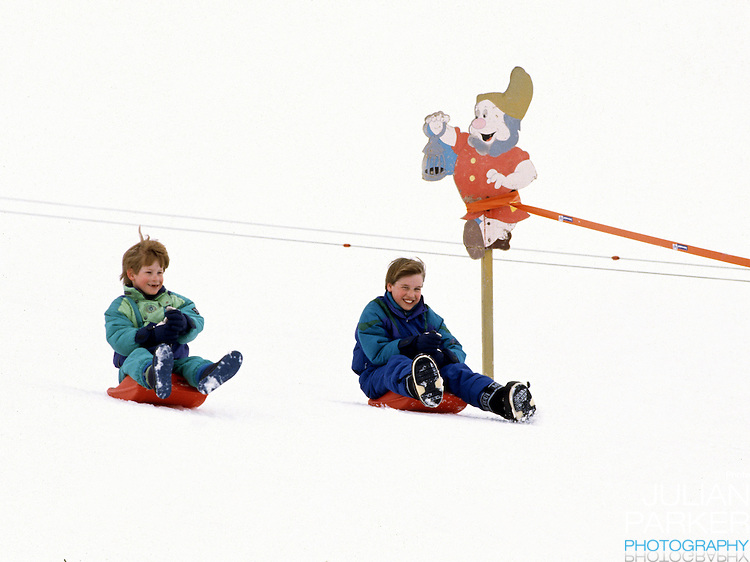 Prince William and Prince Harry sledging, in Lech, Austria, on an annual ski holiday with their mother, The Princess of Wales