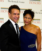 Brian Stokes Mitchell and Allyson Tucker-Mitchell arrive for the formal Artist's Dinner honoring the recipients of the 2012 Kennedy Center Honors hosted by United States Secretary of State Hillary Rodham Clinton at the U.S. Department of State in Washington, D.C. on Saturday, December 1, 2012. The 2012 honorees are Buddy Guy, actor Dustin Hoffman, late-night host David Letterman, dancer Natalia Makarova, and the British rock band Led Zeppelin (Robert Plant, Jimmy Page, and John Paul Jones)..Credit: Ron Sachs / CNP