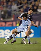 Colorado Rapids defender Kosuke Kimura (27) disrupts advancing New England Revolution midfielder Marko Perovic (29). The Colorado Rapids defeated the New England Revolution, 2-1, at Gillette Stadium on April 24, 2010.