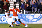 14 December 2007: Virginia Tech's Patrick Nyarko (GHA) (12) pushes the ball past Wake Forest's Julian Valentin (4). The Wake Forest University Demon Deacons defeated the Virginia Tech University Hokies 2-0 at SAS Stadium in Cary, North Carolina in a NCAA Division I Men's College Cup semifinal game.