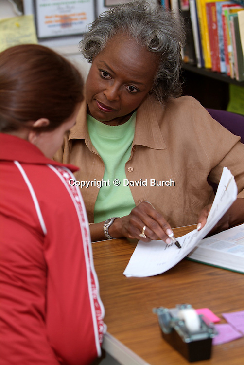 African American woman counciling a student
