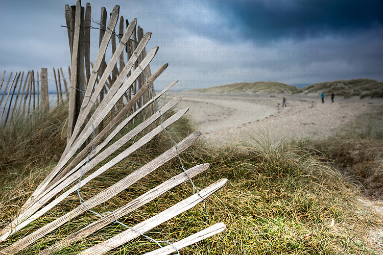 Rural sea view at West Wittering in West Sussex, England with broken fence