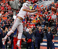 Ohio State Buckeyes wide receiver Devin Smith (9) stretches but can't quite reel in a pass during the second half of Saturday's NCAA Division I football game against Illinois at Memorial Stadium in Champaign, Il., on November 16, 2013. Ohio State won the game 60-35. (Barbara J. Perenic/The Columbus Dispatch)