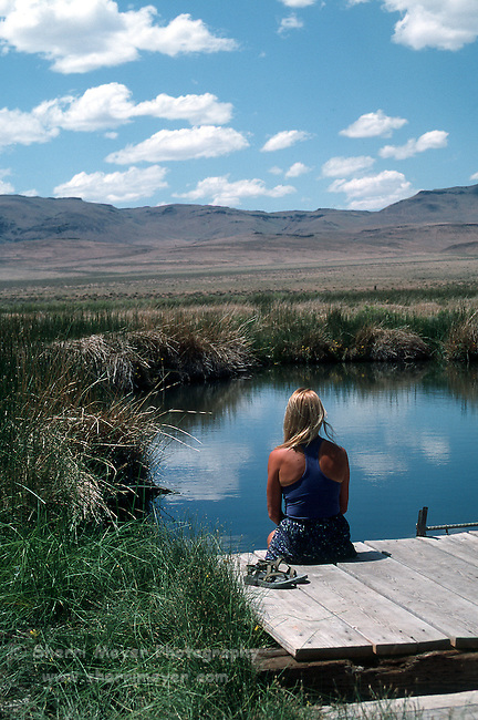 Woman enjoying a hot spring in Soldier Meadows