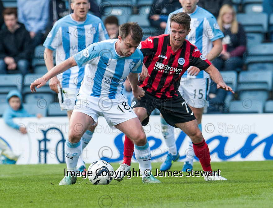 Dundee's Paul McGowan holds off St Johnstone's Chris Millar.