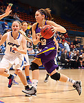 SIOUX FALLS, SD - MARCH 10:  Jackie Rieger #12 from Western Illinois drives against Erin Murphy #12 from IPFW in the second overtime of their quarterfinal game Sunday afternoon at the 2013 Summit League Championships in Sioux Falls, SD.  (Photo by Dave Eggen/Inertia)