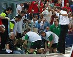 Georgios Samaras ends up in the Celtic dugout hitting John Clark