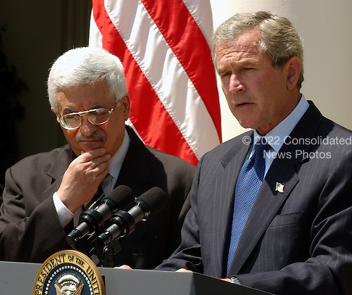 United States President George W. Bush and Prime Minister Mahmoud Abbas of the Palestinian Authority take questions from reporters on their Oval Office talks in the Rose Garden of the White House in Washington, D.C. in Washington, DC on July 25, 2003.  After meeting reporters the two leaders retired to lunch in the Residence..Credit: Ron Sachs / CNP