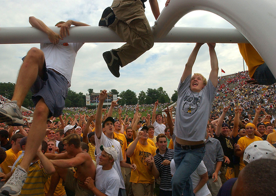 Journal photo by Ted Richardson -- 09/06/03 -- Wake Forest University football fans celebrate an upset victory over N.C. State by jumping onto a goalpost at Groves Stadium.  m DIT SPT 07 elate ric .jpg..J 09-07-03, B1, D. Collins reporter (Story, C1).