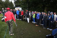 Darren Fichardt (RSA) has to move mountains to get a clear swing at the 16th pin from the trodden ground and spectators  during the Final Round of the British Masters 2015 supported by SkySports played on the Marquess Course at Woburn Golf Club, Little Brickhill, Milton Keynes, England.  11/10/2015. Picture: Golffile | David Lloyd<br /> <br /> All photos usage must carry mandatory copyright credit (&copy; Golffile | David Lloyd)