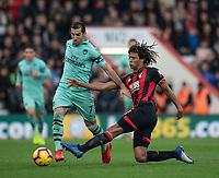 Arsenal's Henrikh Mkhitaryan (left) is tackled by Bournemouth's Nathan Ake (right) <br /> <br /> Photographer David Horton/CameraSport<br /> <br /> The Premier League - Bournemouth v Arsenal - Sunday 25th November 2018 - Vitality Stadium - Bournemouth<br /> <br /> World Copyright &copy; 2018 CameraSport. All rights reserved. 43 Linden Ave. Countesthorpe. Leicester. England. LE8 5PG - Tel: +44 (0) 116 277 4147 - admin@camerasport.com - www.camerasport.com