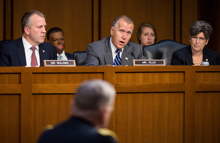 UNITED STATES - JULY 21: From left, Sen. Dan Sullivan, R-Alaska, Sen. Thom Tillis, R-N.C., and Sen. Joni Ernst, R-Iowa, participate in the Senate Armed Services Committee hearing on the nomination of Army Gen. Mark Milley to be Army chief of staff on Tuesday, July 21, 2015. (Photo By Bill Clark/CQ Roll Call)