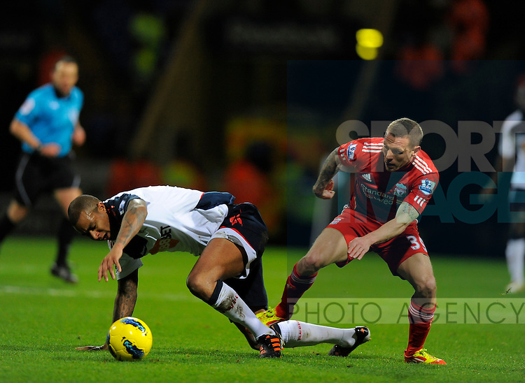 Zat Knight of Bolton Wanderers tussles with Craig Bellamy of Liverpool.Barclays Premier League.Bolton Wanderers v Liverpool at the Reebok Stadium, Bolton. 21st January, 2012..Sportimage +44 7980659747.picturedesk@sportimage.co.uk.http://www.sportimage.co.uk/.Editorial use only. Maximum 45 images during a match. No video emulation or promotion as 'live'. No use in games, competitions, merchandise, betting or single club/player services. No use with unofficial audio, video, data, fixtures or club/league logos.
