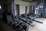 Photo shows piles of  slate that was salvaged from the debris and stored inside the disaster-ruined community hall in Ogatsu, Ishinomaki City, Japan on 9 Sept. 2012.  Photographer: Robert Gilhooly