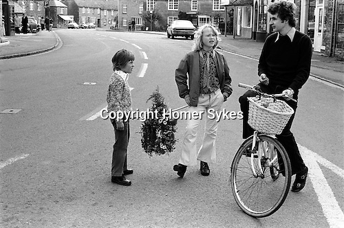 Spring Bank holiday Monday, traditional May garlands of flowers are shown around the village. Bampton Oxfordshire. England 1975