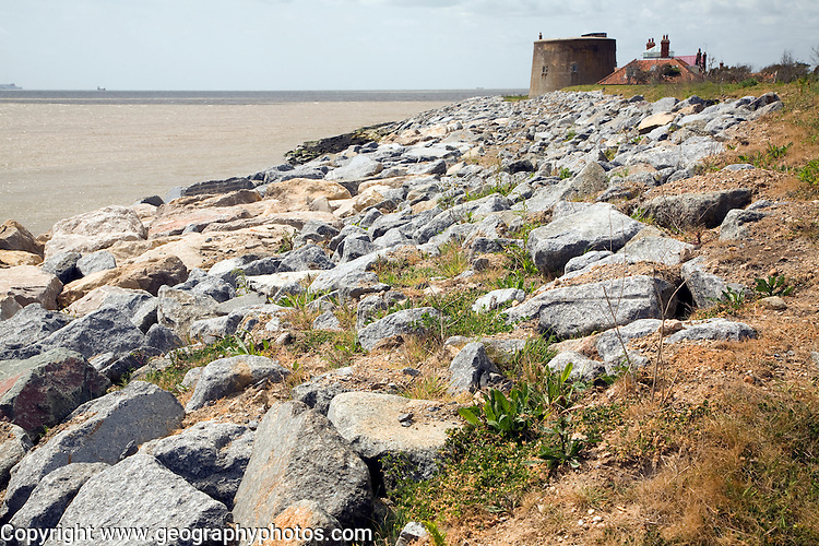 Rock armour coastal defences protect the martello tower East Lane, Bawdsey, Suffolk, England