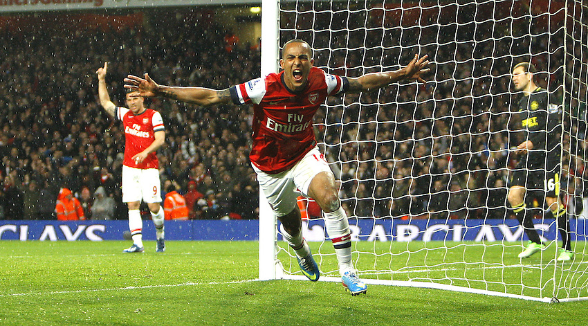 Arsenal's Theo Walcott celebrates scoring his sides second goal 2-1..  (Photo by Karyn Haddon/CameraSport) ..Football - Barclays Premiership - Arsenal v Wigan Athletic - Tuesday 14th May 2013 - Emirates Stadium - London..© CameraSport - 43 Linden Ave. Countesthorpe. Leicester. England. LE8 5PG - Tel: +44 (0) 116 277 4147 - admin@camerasport.com - www.camerasport.com