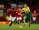 Anthony Martial of Manchester United tussles with Christoph Zimmermann of Norwich City during the Premier League match at Old Trafford, Manchester. Picture date: 11th January 2020. Picture credit should read: James Wilson/Sportimage